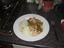 Chicken, mushrooms, a carrot, a spring onion, an half a green pepper with some tasty mash. Um yum.